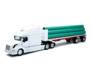 VOLVO VN-780 FLATBED WITH LONG PIPE at diecastdepot