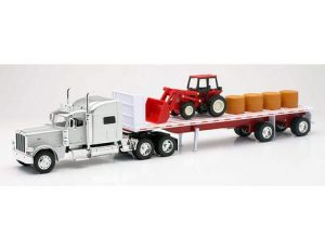 Peterbilt 389 with Flatbed hauling Hay and a Farm Tractor