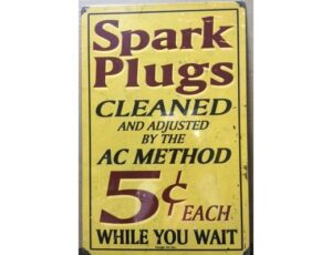 SPARK PLUGS CLEANED METAL SIGN