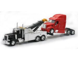 Peterbilt tow truck towing Peterbilt Cab