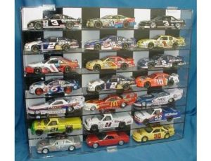 DISPLAY CASE FOR 1:24 SCALE DIE CAST WITH BLACK AND WHITE CHECKERED BACKGROUND