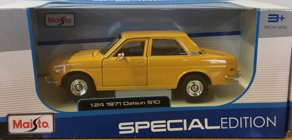 31518 1 - 1971 Datsun 510 - Yellow in 1:24 scale by Maisto