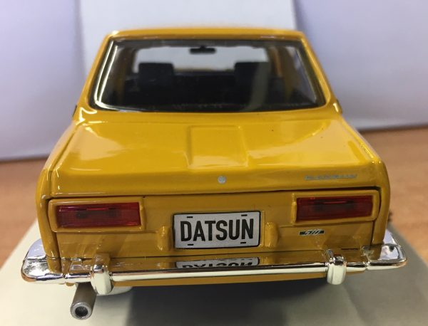 31518c - 1971 Datsun 510 - Yellow in 1:24 scale by Maisto