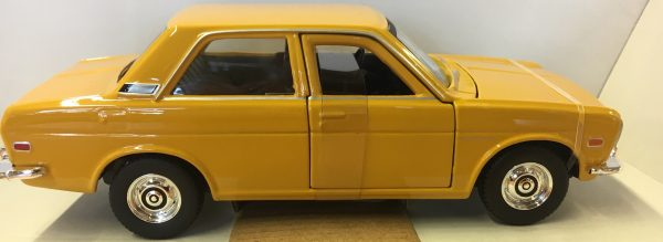 31518g - 1971 Datsun 510 - Yellow in 1:24 scale by Maisto