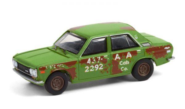 47070b - 1970 Datsun 510 4-Door Sedan - A&A Cab Co. - Green with Rust